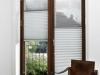 plisy przesuwne montowane w drzwiach balkonowych